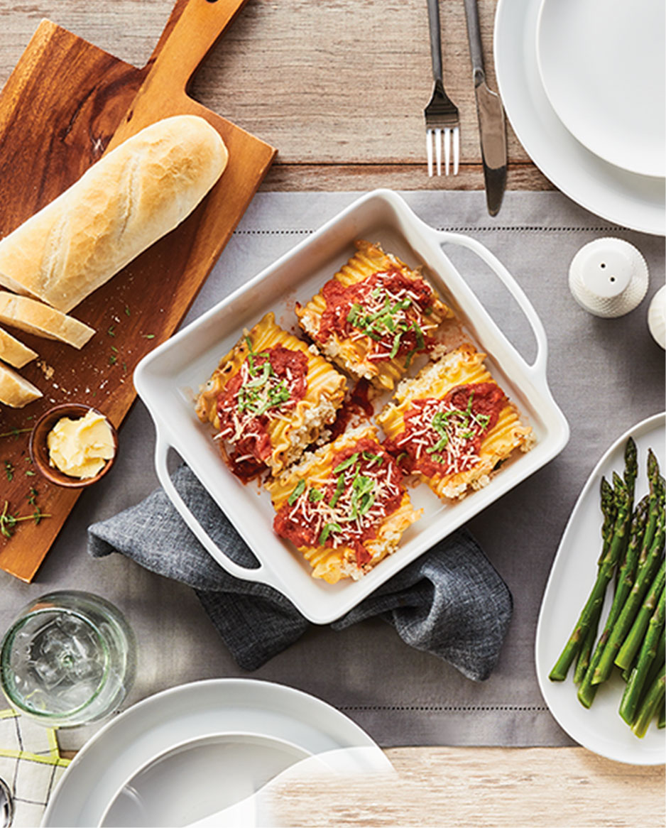 French Bread, Lasagna and Asparagus on a table